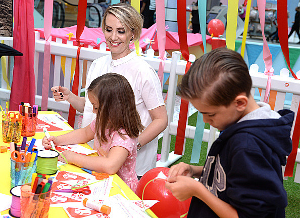 Claire Richards Takes Part In Den Day Fundraising Activities At Westfield London